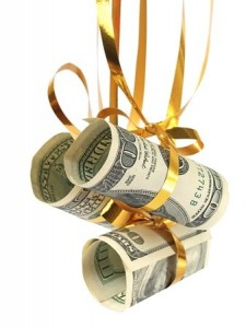 money hanging in holiday bow