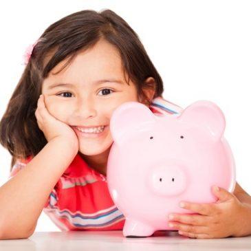 child holding piggy bank