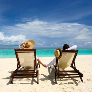 happy couple relaxing on a beach