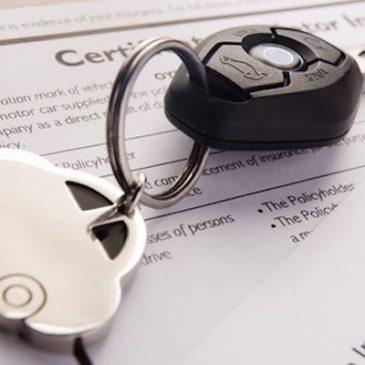 car keys on insurance paperwork