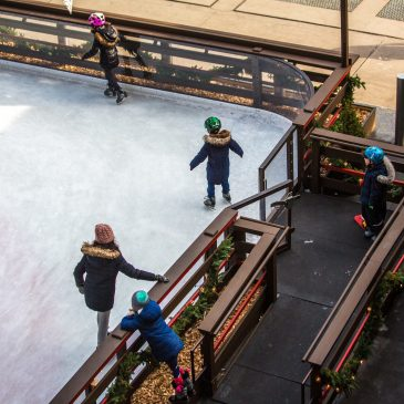 family-ice-skating-in-holiday-ice-rink