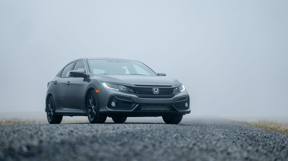 a gray Honda is parked in the fog