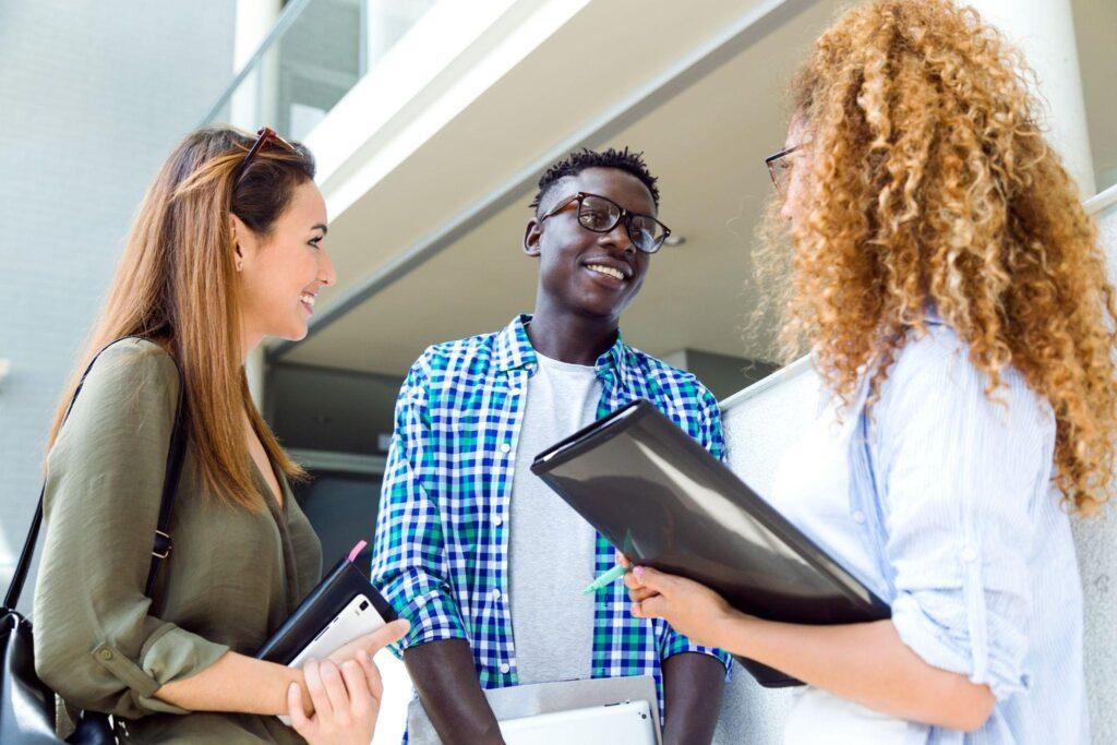 a group of three millennials have a conversation