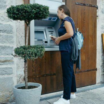 A woman accesses an ATM